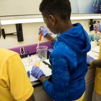 7th and 8th graders from James McHenry Elementary & Middle School aboard the MdBioLab at the UM BioPark